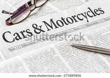A newspaper with the headline Cars and Motorcycles - stock photo