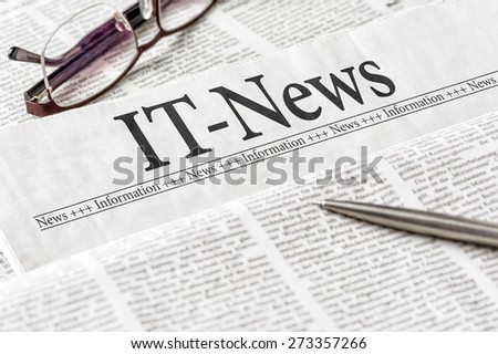 A newspaper with the headline IT-News - stock photo