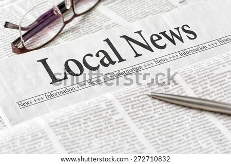 A newspaper with the headline Local News - stock photo