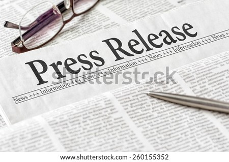 A newspaper with the headline Press Release - stock photo