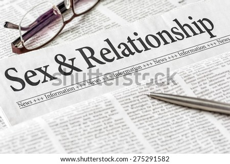 A newspaper with the headline Sex and Relationship - stock photo