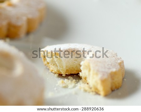 A nibbled italian canestrelli cookies on a plate. This regional cookie is typical of north Italy and Corsica - stock photo
