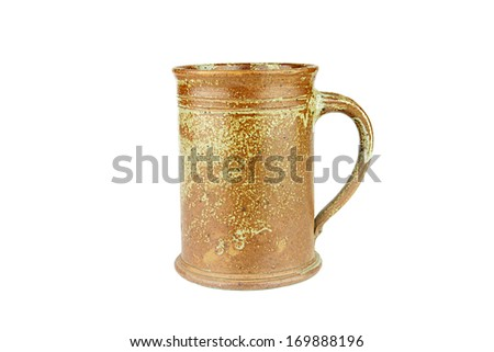A nice brown ceramic mug. Isolated. - stock photo