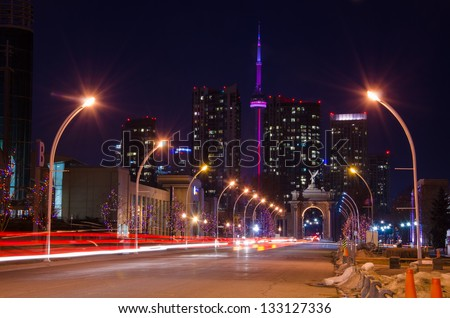 A nice city road leading to the CN Tower - stock photo