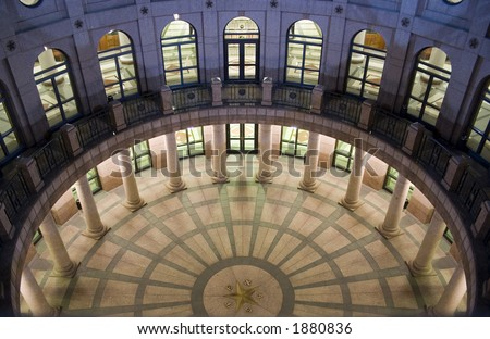 A nice clean shot of the Texas State Capitol Building in downtown Austin, Texas at night.  This is the underground extension as seen from the ground level. - stock photo