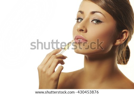a nice girl with syringe making injection