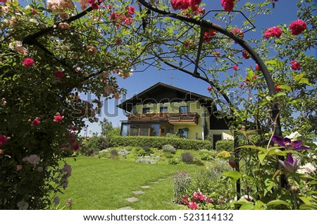 A nice house in a beautiful garden on a sunny day