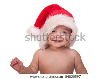 A nice image of a baby wearing a Christmas hat.