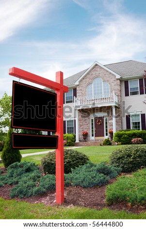 A nice luxury home with a blank for sale sign posted in front.  Plenty of copy space on the empty sign for your text. - stock photo