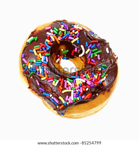 A nice overhead view of a chocolate frosted donut with sprinkles. - stock photo