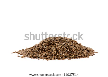 A nice pile of some flax-seed isolated on white background - stock photo