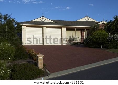 A nice single storey house surrounded by lush garden - stock photo