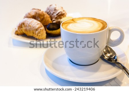 A nice view of Italian capuccino and Italian pastries(pasticcini).