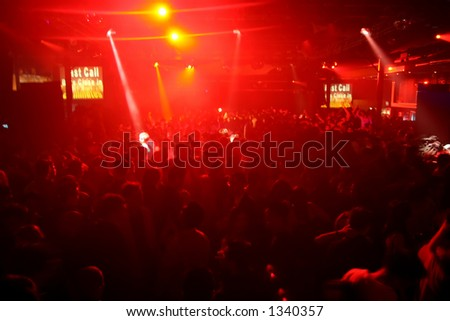 A night club/concert scene with red lights. - stock photo