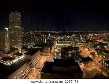 A night image of the Denver downtown core including the Colorado State Capitol. - stock photo