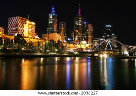 A night shot of Melbourne, Australia, looking across the Yarra River to Flinders Street Station - stock photo