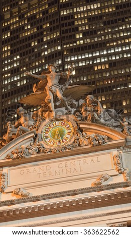 A night view of the statue of Mercury (Hermes) with a clock above the facade of the Grand Central Terminal. 42th street, Manhattan, New York City. - stock photo