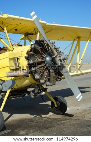 A nine cylinder 600 horsepower radial engine powers this crop duster during its heavy workload - stock photo