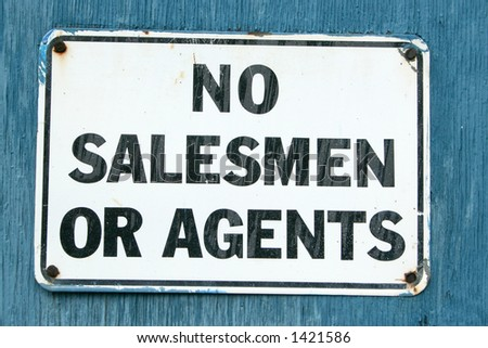 "A ""No Salesmen"" sign on an aged blue background. - stock photo"