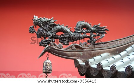 A noble roof dragon used to lure in prosperity into the temple - stock photo