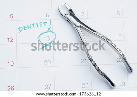 A note of a dentist appointment on a calendar, extraction of tooth