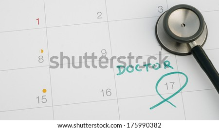 A note of a doctor appointment on a calendar - stock photo