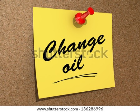 A note pinned to a cork board with the text Change Oil. - stock photo