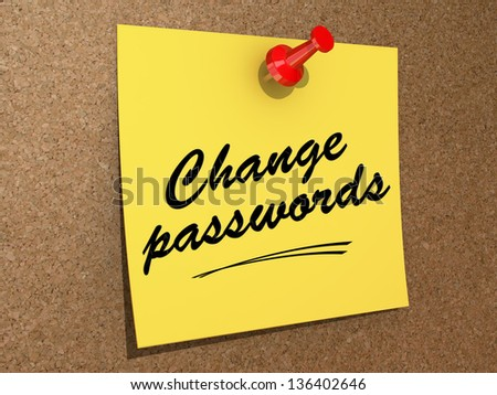 A note pinned to a cork board with the text Change Passwords. - stock photo
