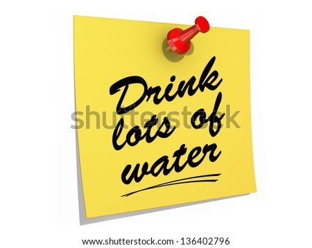 A note pinned to a white background with the text Drink Lots of Water. - stock photo