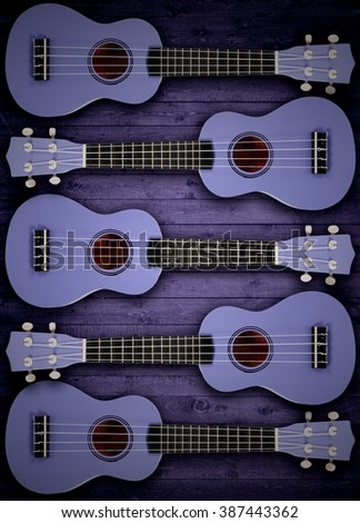 A number of acoustic guitars in the background. Write text. - stock photo