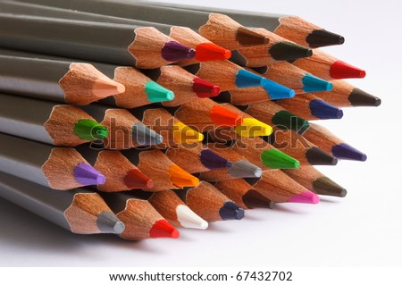 A number of colored pencils on white background - stock photo