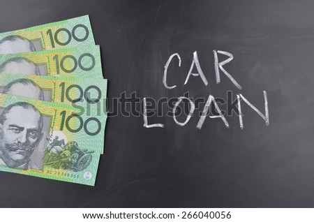 A number of one hundred Australian dollar notes on a blackboard where Car Loan is handwritten in white chalk - stock photo