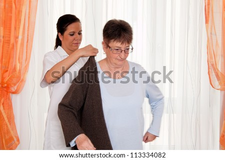 a nurse in elderly care for the elderly in nursing homes - stock photo