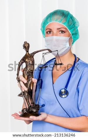 a nurse or doctor in surgical clothes before surgery. symbol photo for work in the hospital - stock photo