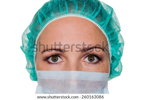a nurse or doctor in surgical clothing before surgery. symbolic photo for stress and overtime in the hospital. - stock photo