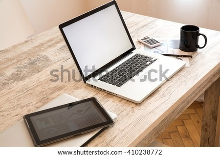 A office setup with a Laptop computer and a Tablet PC.  - stock photo