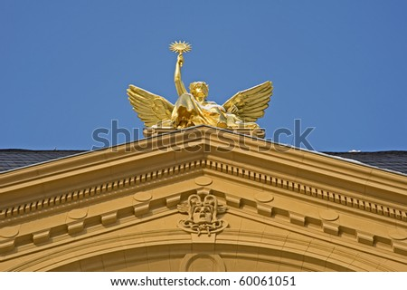A old gilded figure on the roof of Theater in Gera , Thuringia, Eastgermany - stock photo