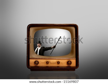 a old television with a announcer - stock photo