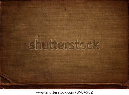A old worn piece of cloth, from the back of a vintage textbook. - stock photo