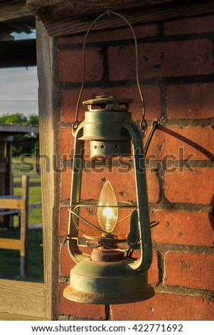 a once oil lamp made into a light bulb holder - stock photo