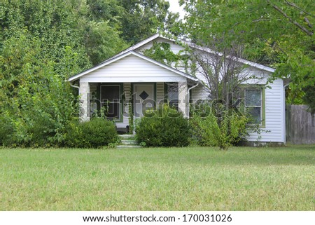 A one-family house in America with lots of trees around - stock photo