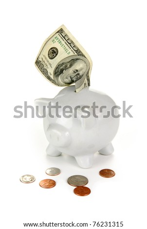a one hundred dollar bill in a piggy bank with small change