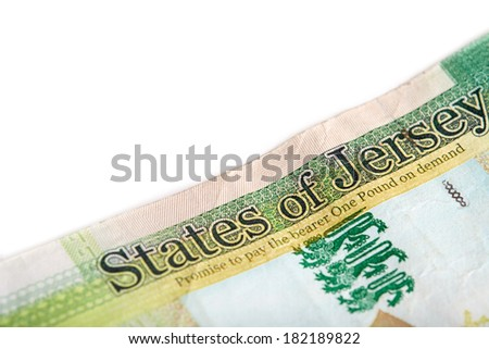 A one pound note from the Island of Jersey on a white background. - stock photo