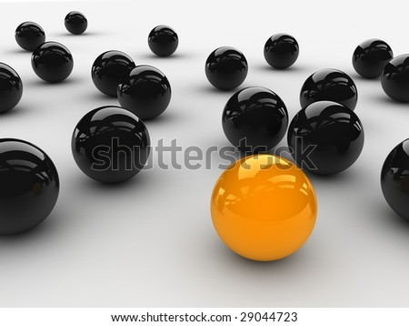 a orange ball placed observably in a group of black balls.
