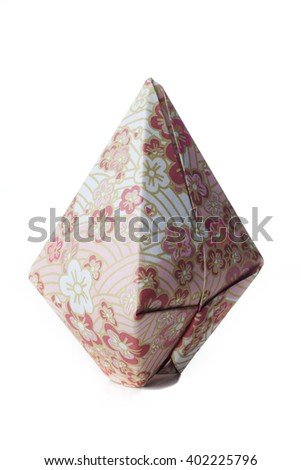 A origami balloon made of colored flowery paper isolated on white background. - stock photo