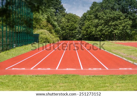 A outdoor racetrack within a green Park Area at a sunny day. - stock photo