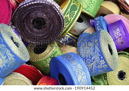 A pack of colorful ribbon rolls