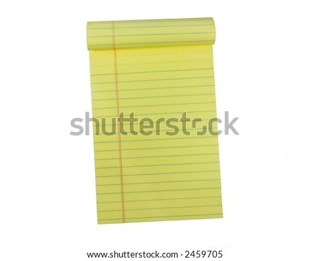 A pad of yellow lined paper - stock photo