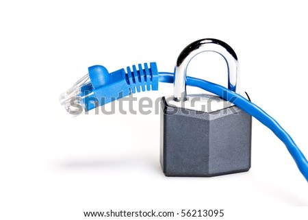 A padlock and keys with ethernet cables showing internet security - stock photo