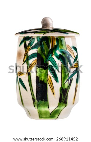 a painted chinese bamboo pot isolated over a white background - stock photo